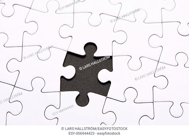 Seamless white puzzle piece background pattern with one piece missing. Conceptual image of connection, solution and business strategy