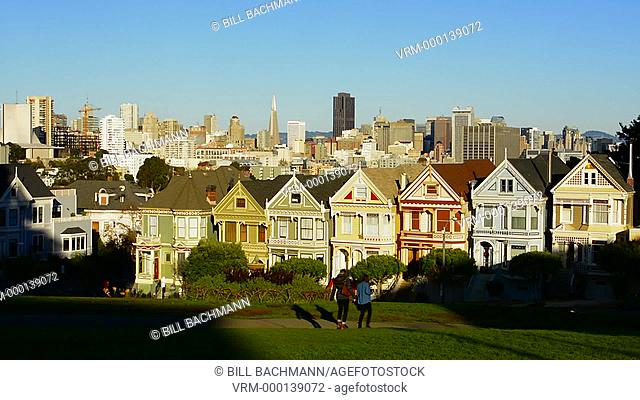 San Francisco California Painted Ladies Victorian homes and city in background at Alamo Square at Hayes Street and Steiner Street