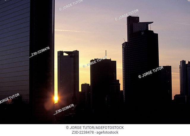 Color , Frankfurt am Main at sunrise. Sun between Frankfurt skyline skyscrapercity silhouette business center , No people