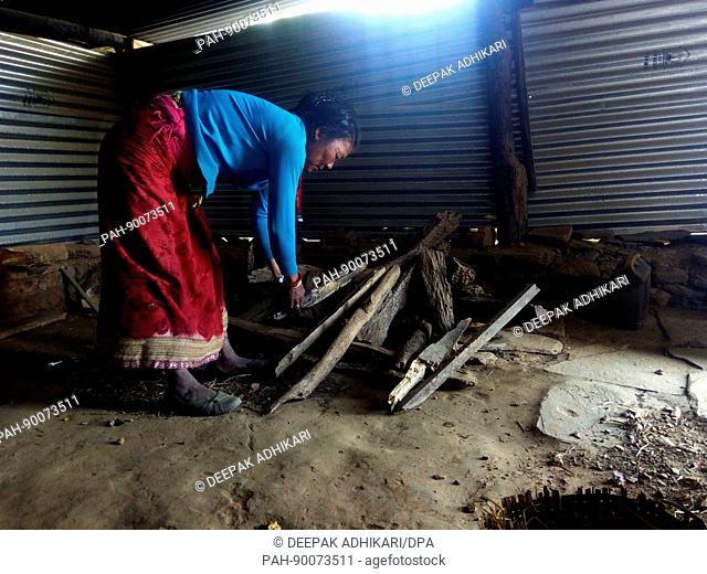 The 51-year-old woman Chinimaya Shrestha standing in a corrugated iron hut, her refuge since the 2015 earthquake which destroyed her house and buried her...