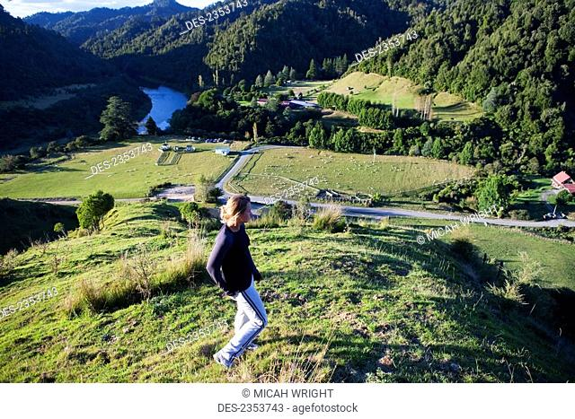 A Young Woman Admiring The View Overlooking Blue Duck Valley At Blue Duck Lodge, In Whanganui National Park; Whakahoro, New Zealand