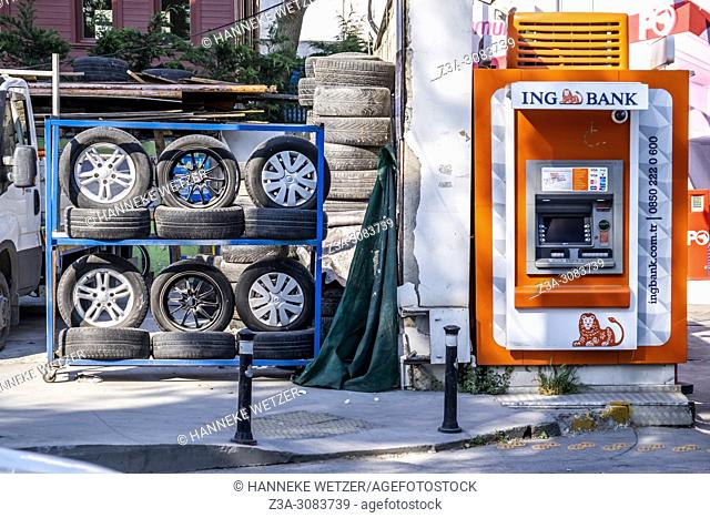 Tire stand next to a ING cash machine in Istanbul, Turkey
