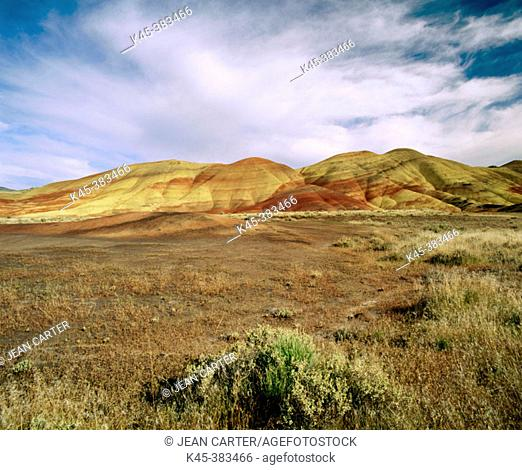 Painted Hills under cloudy sky, John Day Fossil Beds National Monument. Oregon. USA