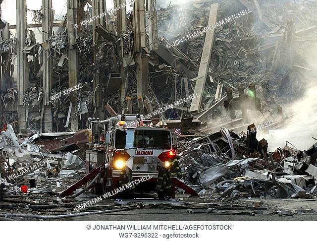 USA New York -- 16 Sep 2001 -- Rescue workers conduct search and rescue attempts, descending deep into the rubble at 'Ground Zero' at the World Trade Center in...