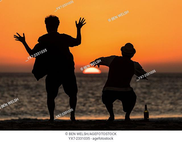 People at sunset in silhouette