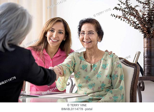 Mother and daughter meeting financial adviser