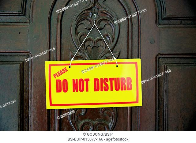 Hotel door. Do not disturb sign