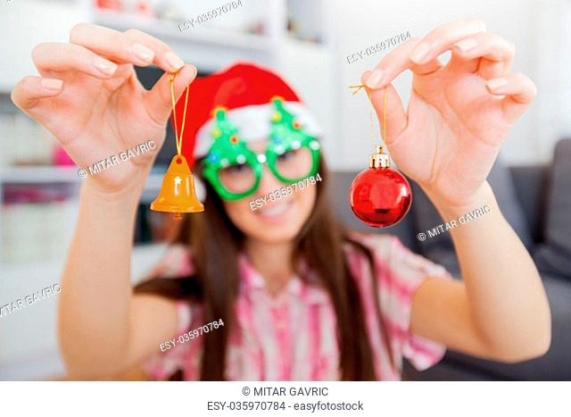 Christmas portrait of happy beautiful woman with Xmas decoration at home