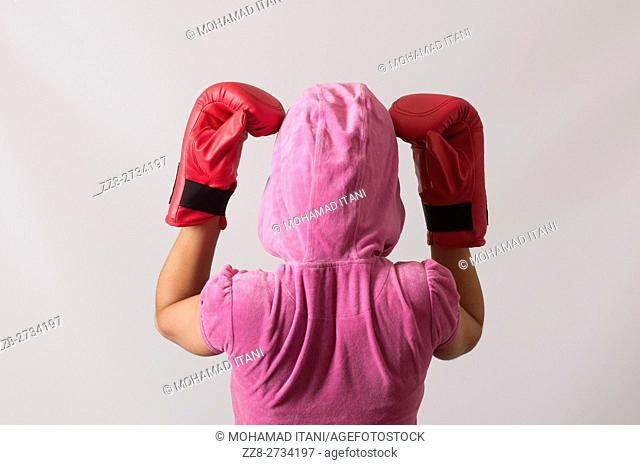 Rear view of a hooded female boxer