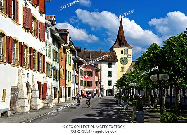 Main sqaure, bourg, with clocktower Gate in the old town of Le Landeron, Swiss Heritage Site, canton of Neuchâtel, Switzerland