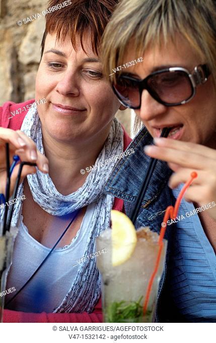 Woman drinking mojito, Benidorm, Costa Blanca, Alicante
