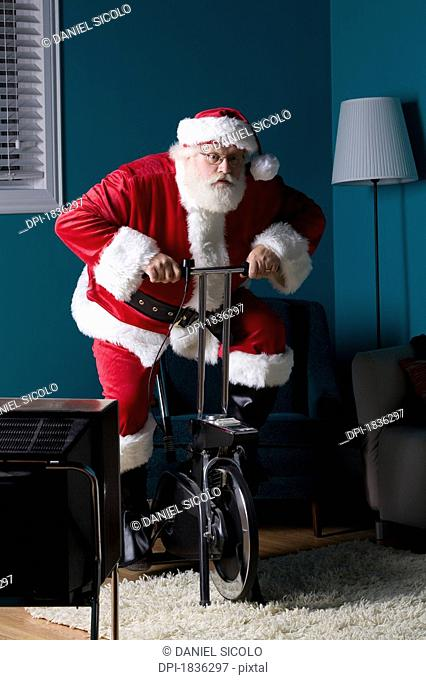 Santa riding stationary bike