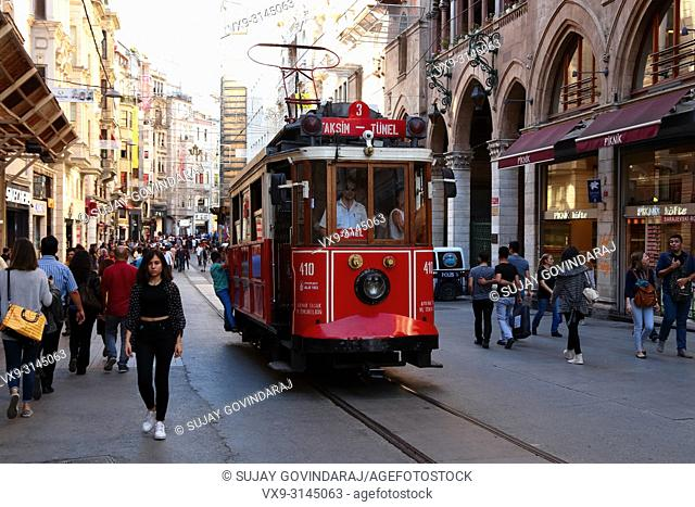 Istanbul, Turkey - June 10, 2016: Passengers travelling on old tramway and crowd in a busy street of Istanbul