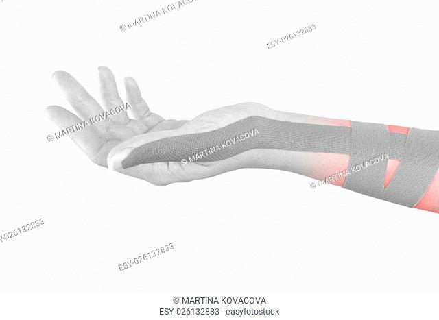 Kinesio tape on female hand isolated on white background. Chronic pain, alternative medicine. Rehabilitation and physiotherapy