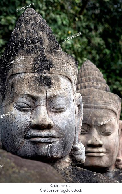 This stock photo shows a detail pf two of the temple stone sculptures at the famous Angkor Wat Temple near Siam Reap in Cambodia
