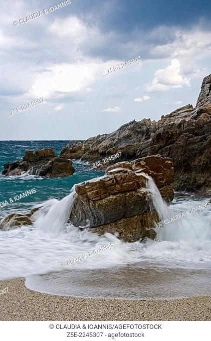 Rocky bay on Pelion Peninsula, Thessaly, Greece, on a cloudy day