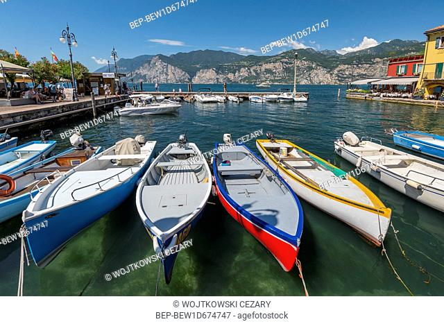 Fishing boats in the harbour of Malcesine village, Lake Garda, Italy