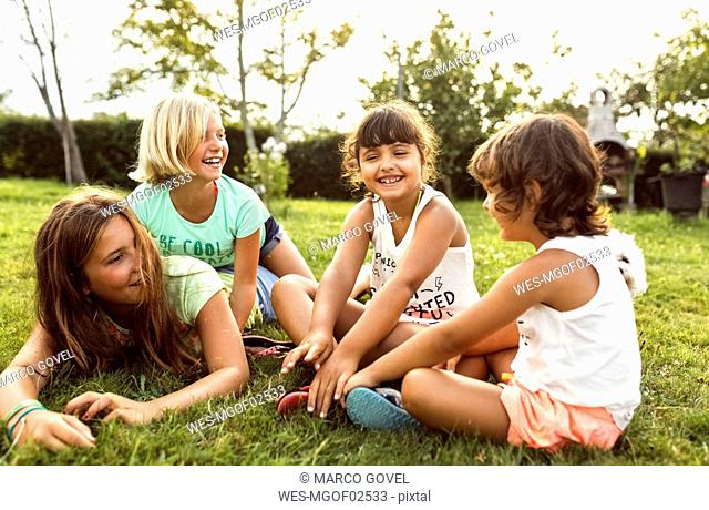 Four girls having fun together on a meadow