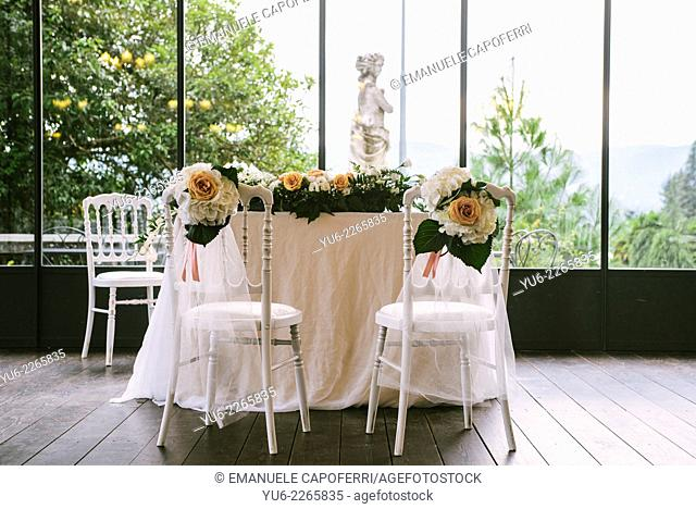Chairs decorated with flowers for wedding