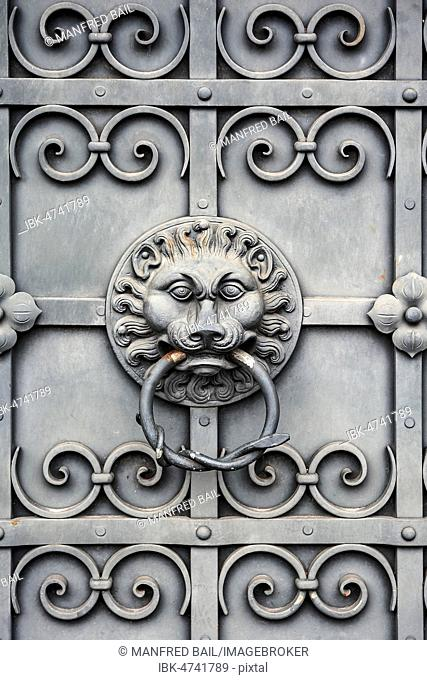 Iron gate with lion's head as door knocker, at the National Museum, Munich, Upper Bavaria, Bavaria, Germany