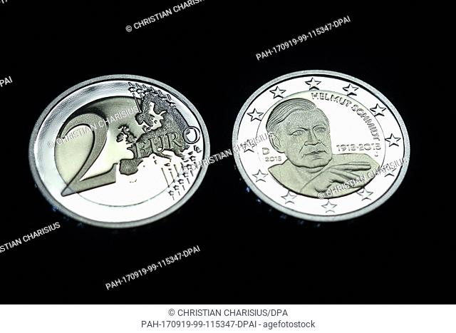 Two newly minted 2-Euro-coins with the portrait of the former German Chancellor Helmut Schmidt can be seen on a tray in the mint 'Hamburgischen Muenze' (lit