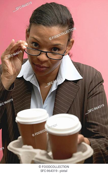 Businesswoman offering two cups of coffee