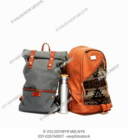The suitcases, thermos on white background. The travel, tourism and holidays concept