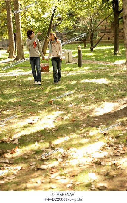 Young women walking in field