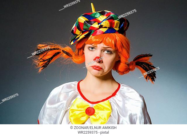 The clown in funny concept on dark background