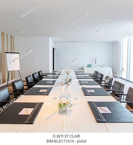 Empty meeting table in conference room