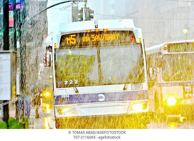 Morning rush hour traffic, Mass Transit, MTA Public Transportation Buses, Metropolitan Transportation Authority, winter storm, raining and snowing