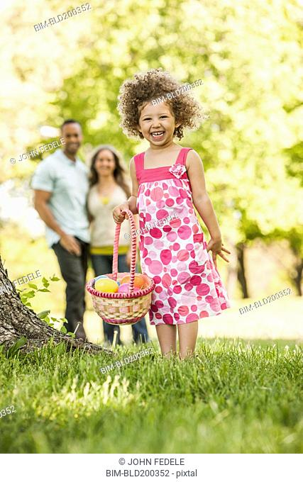 Mixed race girl on Easter egg hunt