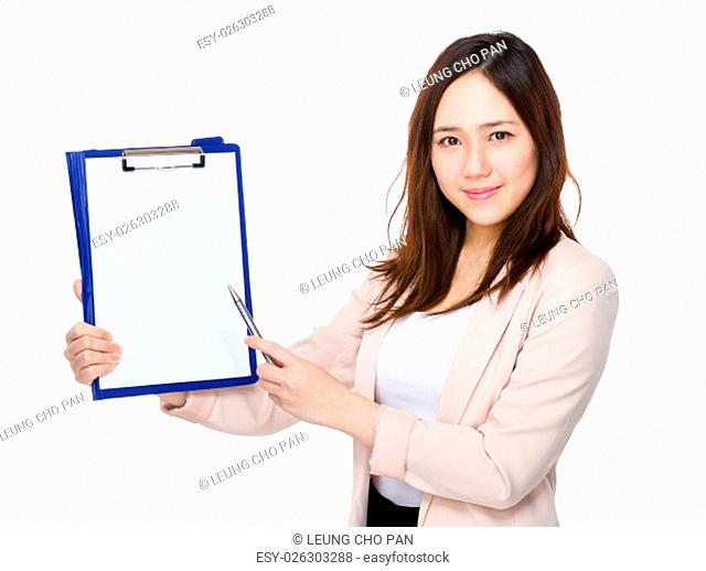 Businesswoman with pen point to clipboard