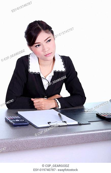 business woman sitting on her desk and thinking with documents s