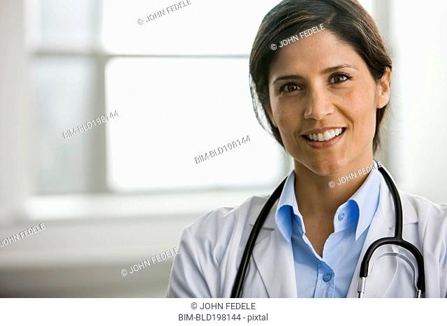 Smiling Hispanic doctor