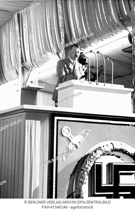 "The image from the Nazi Propaganda! shows Reich Chancellor Adolf Hitler delivering a speech on the final congress of the Nuremberg """"Rally of Labour"""" on the..."
