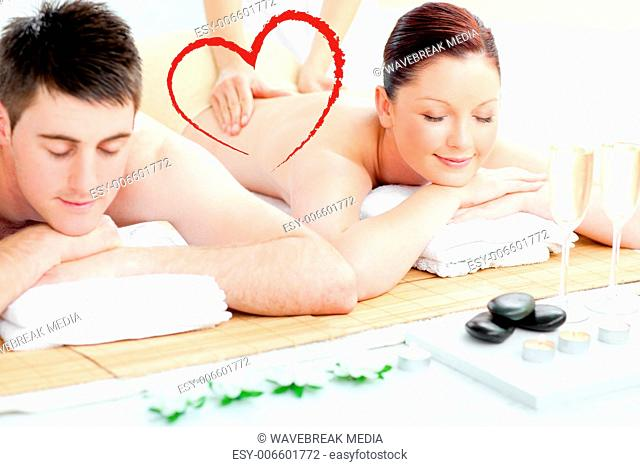 Composite image of charming young couple enjoying a back massage