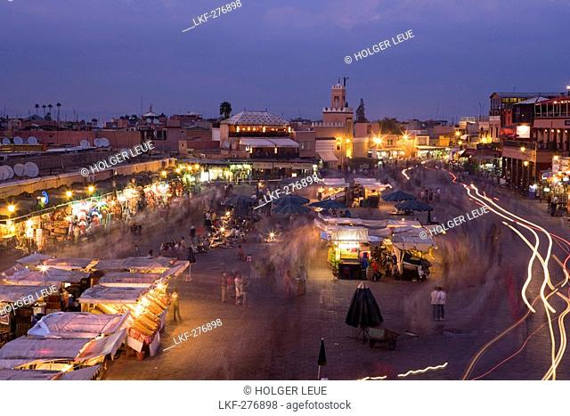 Djemaa el Fna Square at dusk, view from the terrace of Cafe Glacier, Marrakesh, Morocco, Africa