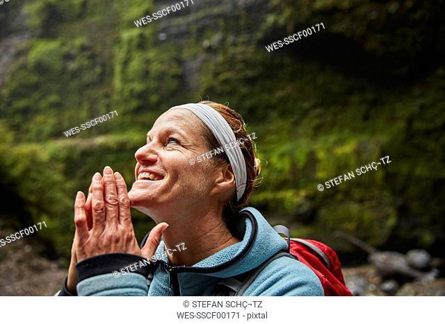 Chile, Patagonia, Osorno Volcano, portrait of woman admiring Las Cascadas waterfall