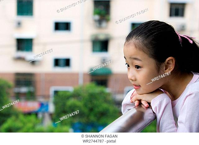 Girl leaning on a railing