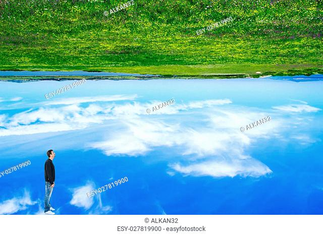 man looking at a upside down world