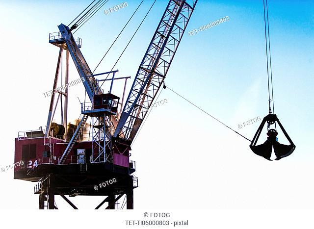 Crane against blue sky