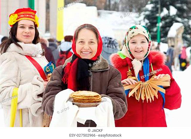 women with pancake during Pancake Week at Russia