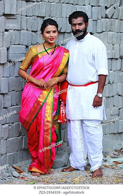 Portrait of Maharashtrian couple dressed in Nauwari sari and Kurta