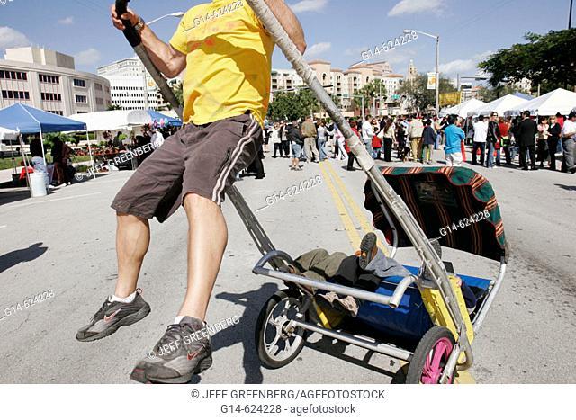 Florida, Coral Gables, Asian New Year Festival. Rickshaw taxi, children ride