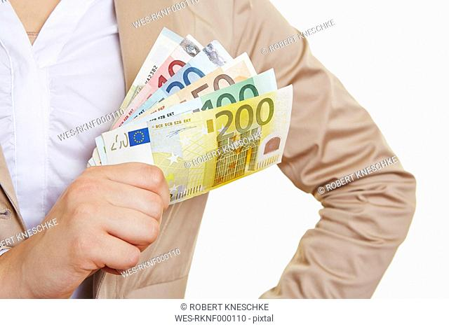 Female hand holding fanned euro notes