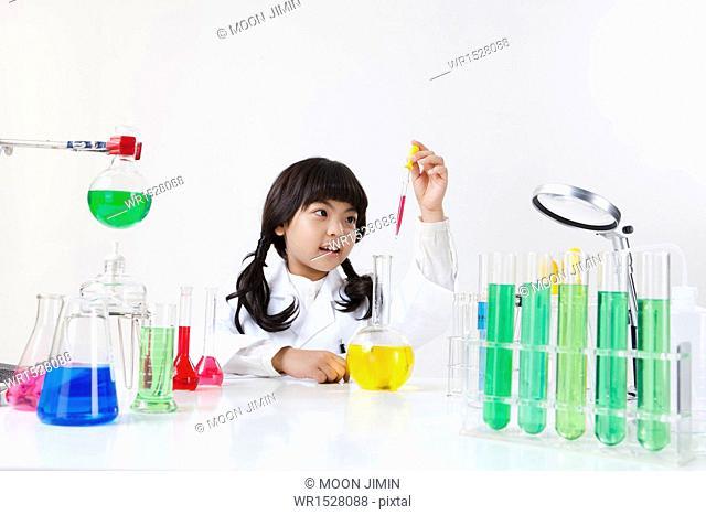 a girl doing chemistry