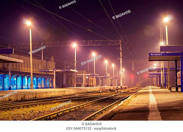 The train station at night. One train