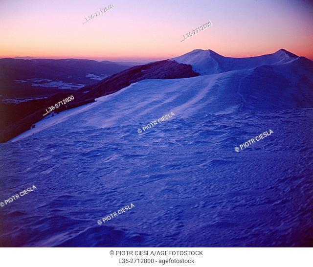 Poland. Bieszczady Mountains in winter. In the back ground to the left the Tatra Mountains