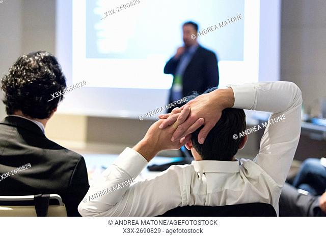 Business man during a conference presentation